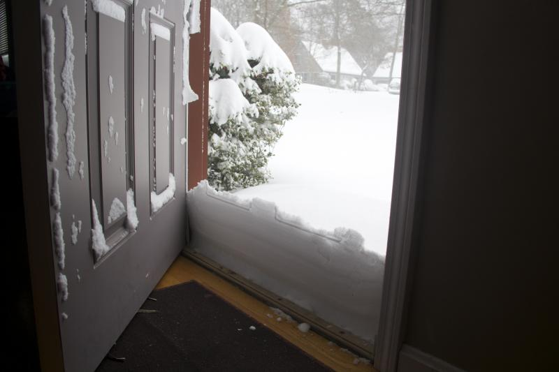 Snow drifts at a front door in Mashpee.