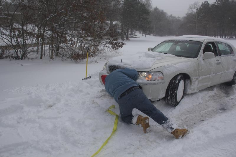Driver gets pulled out of a Snow Bank not far from his home.