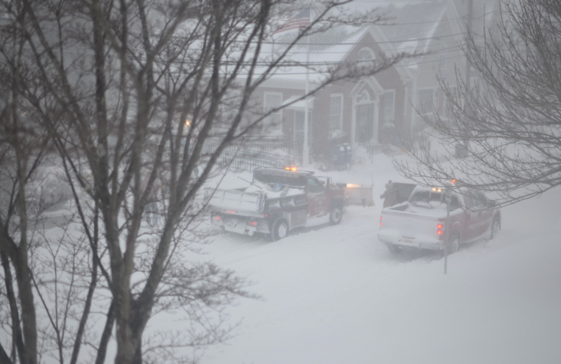 A plow travels slowly down Water Street in Woods Hole at 7:40 am on Friday.