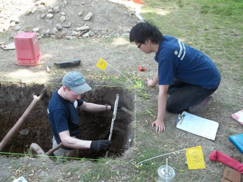 Eric Johnson and Xinli Huang, part of the team excavating at Burial Hill.