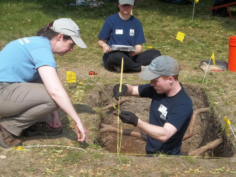 Christa Beranek, Xinli Huang, and Eric Johnson, at the excavation at Burial Hill.