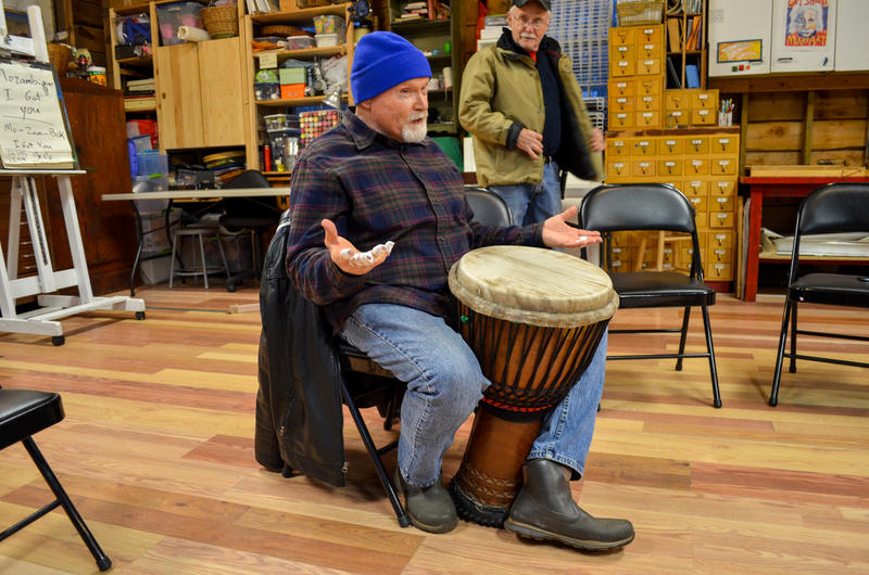 Sam Holmstock (left) leading a drum circle for veterans with PTSD while Dave Brown (right) looks on. April 2015. Cotuit