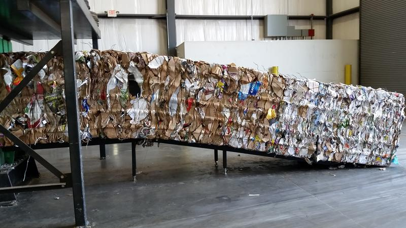 Recyclables, like the paper shown here, are sorted and baled in preparation for shipment overseas to be repurposed. The international commodities market can fluctuate, causing spikes and drops in prices for metal, paper, plastic and glass.