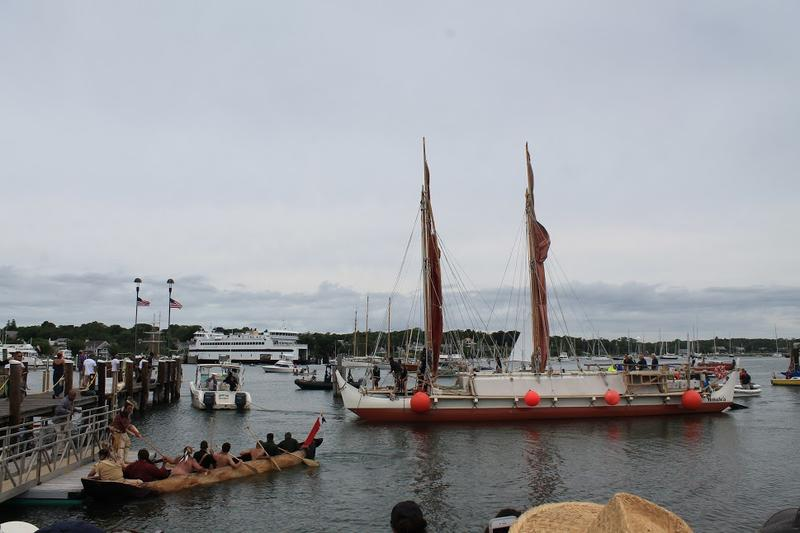 Traditional Polynesian voyaging canoe, Hokule'a, greeted by the first mishoon built and launched by Wampanoag of Aquinnah in centuries.