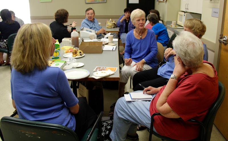 Participants talk about death and dying issues during a Death Café at the Barnstable Senior Center