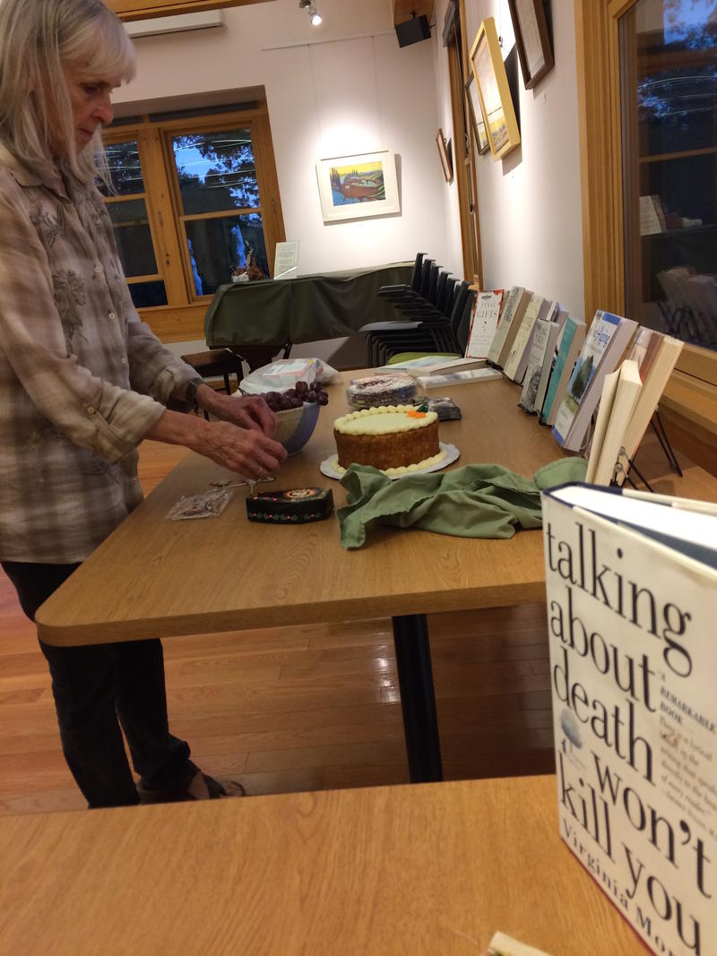 Joyce Maxner sets up for a Death Cafe in West Tisbury, Martha's Vineyard.
