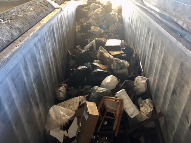 At the Martha's Vineyard Refuse District in Edgartown, trash is put into truck beds before heading for an off-island ferry ride.