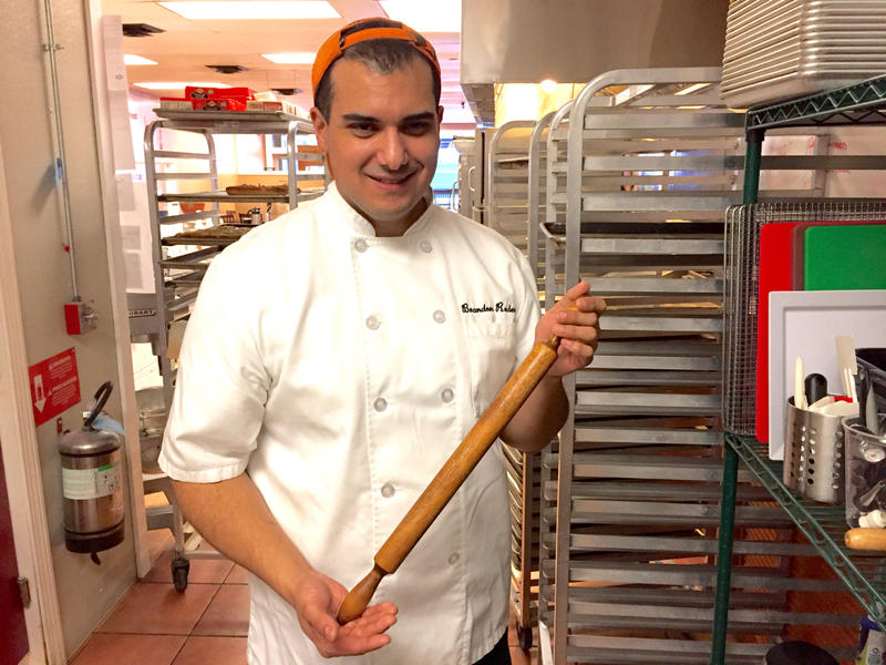 Brandon Roderick in the kitchen with his Nana's rolling pin