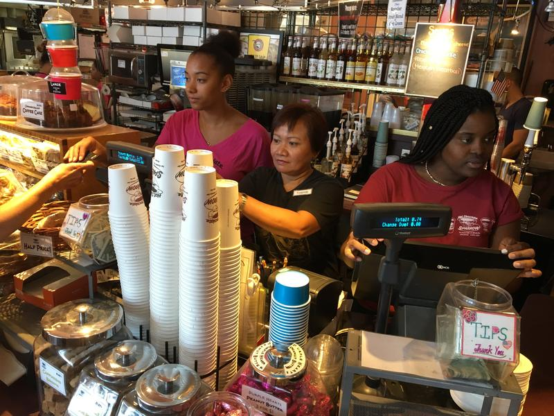Yolando Tomayo (center) was delayed four months returning to her job at Hot Chocolate Sparrow, in Orleans, because she was unable to get an H2B visa earlier in the season.