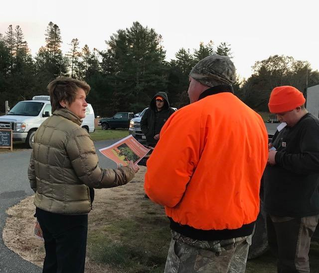 Rebecca Haag, executive director of Island Grown Initiative, greets hunters at the weigh-in station.  She's encouraging hunters to bring in more deer than they need, and donate the extra to the food pantry.