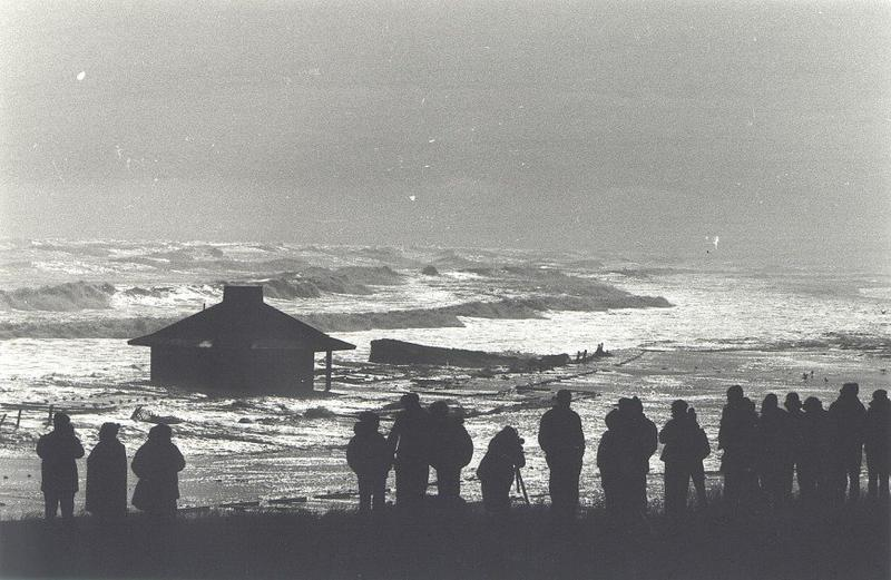 Sightseers at Coast Guard Beach in Eastham watch the 1978 storm battering the bathhouse,