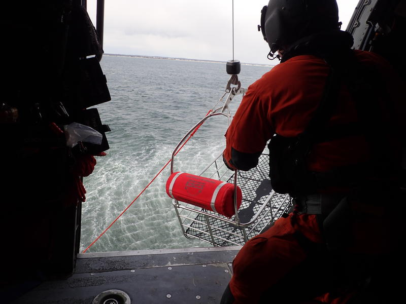 A view from within the helicopter during a search and rescue drill