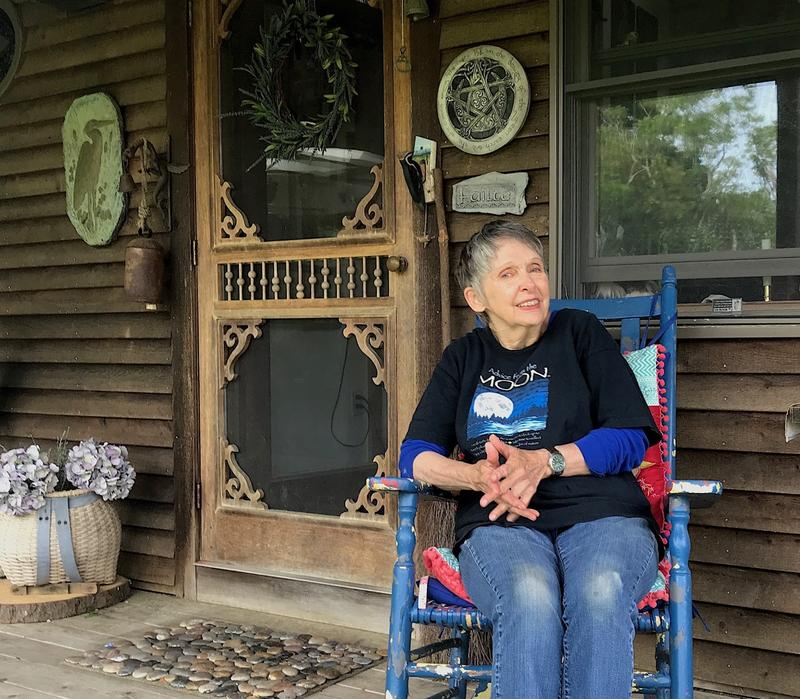 Judy Ellis on the porch of her house on Snake Creek Road.  She designed the house and has lived in it for 21 years.