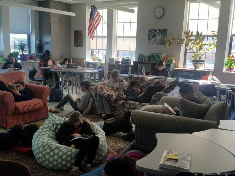 Students reading in their classroom at the Cyrus Peirce Middle School