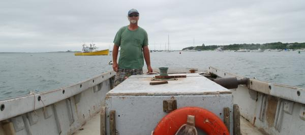 Ernie Eldredge at the helm of one of three boats he and his crew use for tending their weirs in Nantucket Sound, near Chatham.
