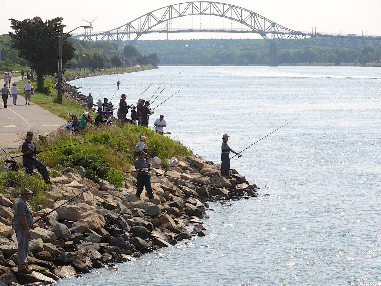 Full moon tides bring big striped bass action to cape cod for Cape cod canal fishing report