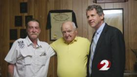 Richard Young flanked by Senator Sherrod Brown and a fellow veteran
