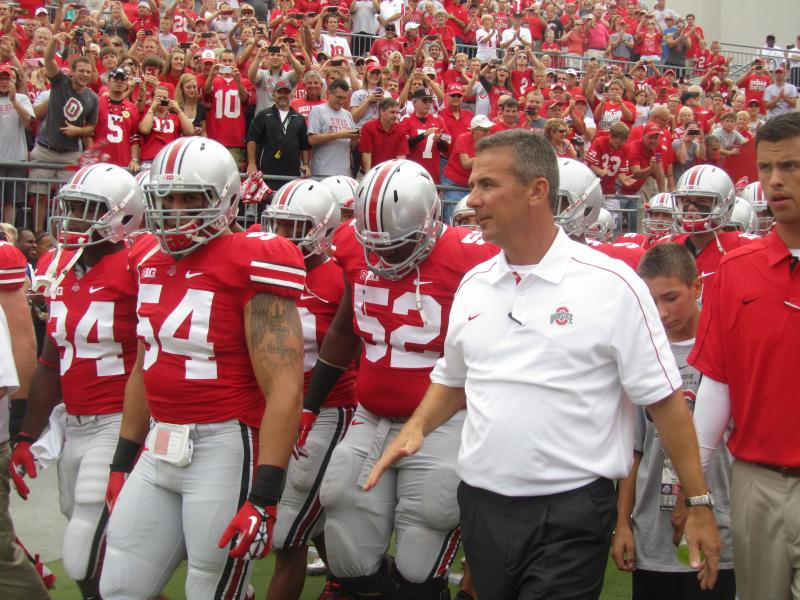 Urban Meyer leads his Buckeye squad to the field for the first time.