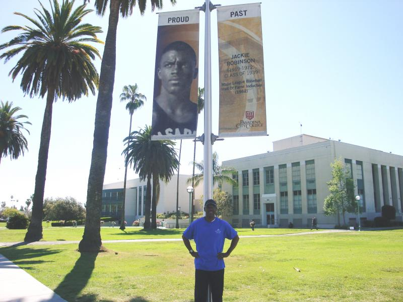 Marchbanks under Jackie Robinson banner at Pasadena City College (April 2013)