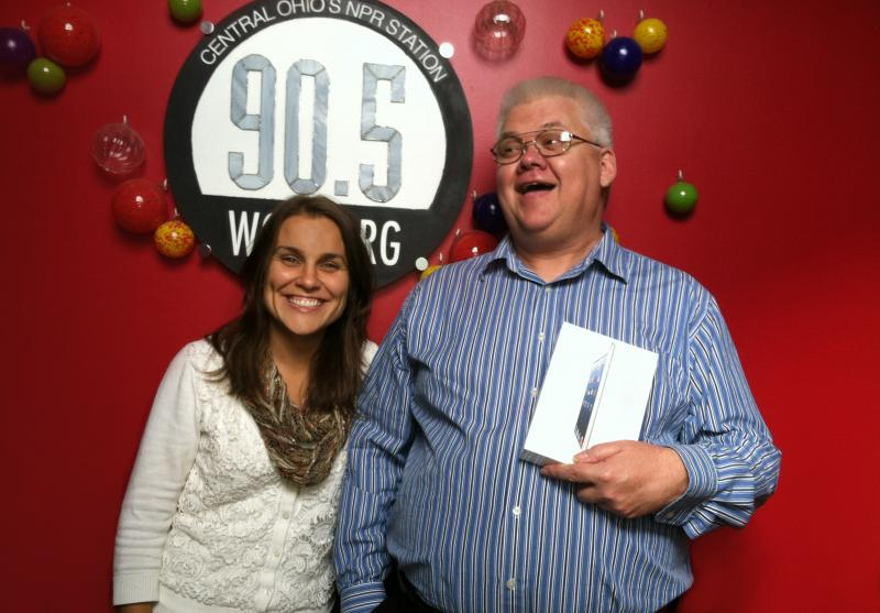 Richelle Antczak McCuen & Dana Weeks giggle with delight just thinking about how Dana can listen to WCBE anywhere in the world on his new iPad Mini.