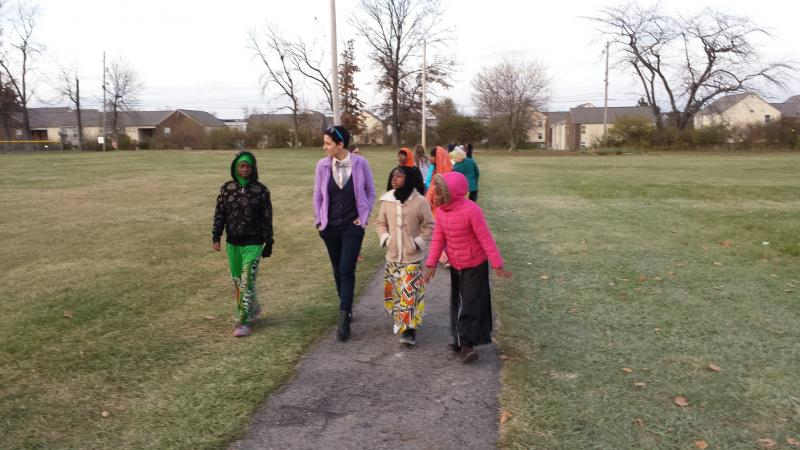 Jess Mathews walks with part of her class in the Village of Urbancrest