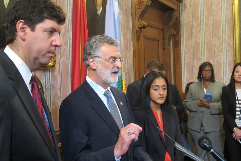 Mayor Frank Jackson (center) flanked by U.S. Attorney for Northeast Ohio Steve Dettelbach (left) and Vanita Gupta of the DOJ's Civil Rights Division (right).