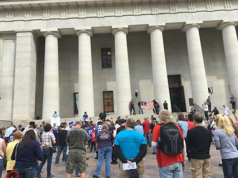 Trump supporters listen at Statehouse rally