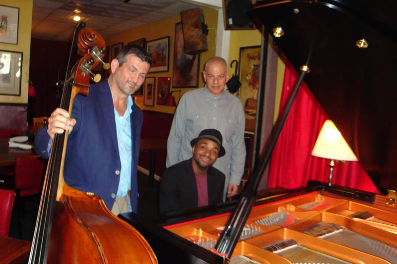 Sullivan Fortner Trio, Sullivan seated at piano