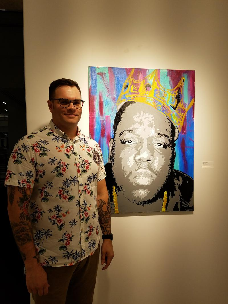 Johnathan Walker of the Air National Guard with his acrylic on canvass titled Biggie