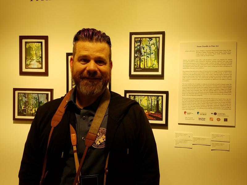 Veteran Shawn Augustson with his camo landscape pieces