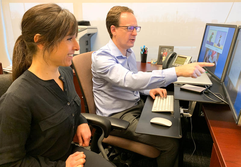 Researchers Derek Houston and Claire Monroy review data after conducting the first study to examine cognitive development in deaf infants.