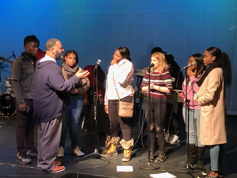 Paragon Project founder Tony Anderson advises his students during a rehearsal.