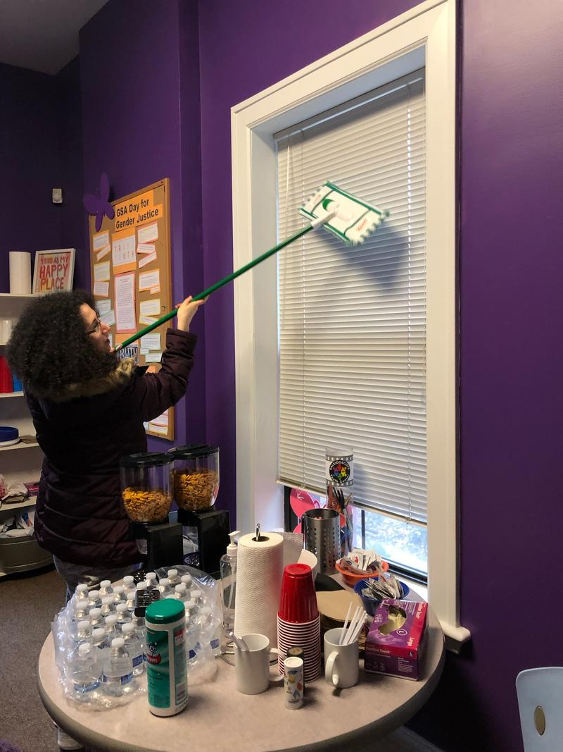 CGB volunteer Gina Loewengart helps with cleanup tasks at the Kaleidoscope Youth Center