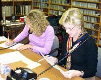 Volunteers take listener pledges during Membership Drives.