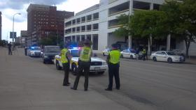 Illinois State and City of Peoria Police conduct a roadside safety check Wednesday on SW Jefferson Street.