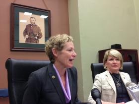 Reps. Darlene Senger (left) and Elaine Nekritz discuss pensions in a Statehouse conference room.