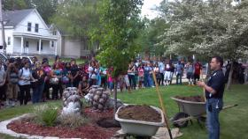 PHS Principal Brett Elliott, students and others gather at the tree planting remembering Darnell Hunter