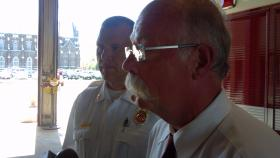 Peoria Fire Department Chief Kent Tomblin (right) and Division Chief Ed Olehy speak with the media following the recovery efforts.