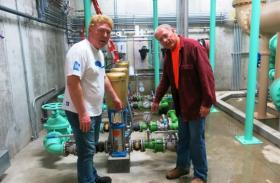 Staunton, Ill., Mayor Craig Neuhaus (left) checks out the town's new water plant with Hank Fey, a public works director. (Bill Wheelhouse/Harvest Public Media).