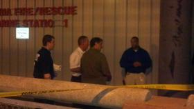 Emergency workers wait for the coroner to arrive at the Fire Department's Marine Rescue Station.