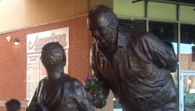 The statue in Dozer Park of Pete Vonachen handing a baseball to a child. It's called 'Peoria's Mr Baseball'.  It was unveiled as part of his 80th birthday. Pete Vonachen died Monday, June 11th at 87-years old.