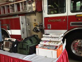 The ALS fire truck on SW Jefferson Avenue, with a display of new medical and emergency-response equipment.