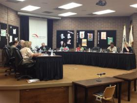 Members of the District 150 School Board during Monday's meeting.
