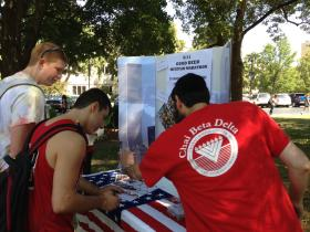 Rabbi Eli Langsam (right) gets students to do a good deed in memory of 9/11.