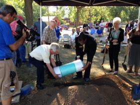 Peoria Park District and Proctor Recreation center officials bury capsule.