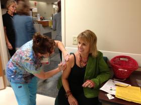 OSF Saint Francis Medical Center spokeswoman, Shelli Dankoff, receives a flu shot.