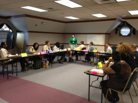 Staff with the Local Initiatives Support Corporation (LISC) train AmeriCorps members.