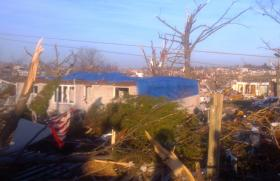 A Washington, Illinois resident tries to secures what's left of their home. There are some homes in the tornado's path with nothing left to secure.
