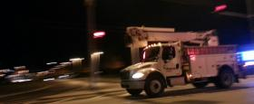 An Ameren truck heads south on Illinois Route 40 Sunday night, as crews continue to restore power to thousands of residents.