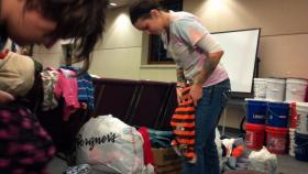 Bloomington residents Cindal Price, left, and Kayla Patton brought clothes from home and helped hand out items at the Crossroads United Methodist Church in Washington.